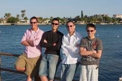 Senior Spring-Break buddies. Four high school senior buddies hanging out waterside in Florida over Spring-Break Stock Photos