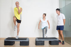Senior step exercise with personal trainer Royalty Free Stock Image