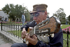 Senior street Guitarist, Buenos Aires, Argentina. Argentinas capital, city of Buenos Aires: an elderly street musician is making music in the park for Eglisa the Stock Photography