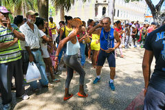 Senior street salsa in Havana. Cuba, Havana - 07 April, 2016: street dances of salsa in one of the central squares in Havana, where both the locals and the Royalty Free Stock Photo