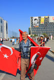 Senior Street Vendor. ISTANBUL - JUN 3: A festival atmosphere prevailed Monday in Taksim Square on June 3, 2013 in Istanbul, Turkey. Protests set off by a police Royalty Free Stock Photos