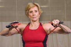 Senior Strength Workout. Senior woman doing strength workout at wellness center Royalty Free Stock Photo