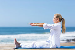 Senior stretching beach Royalty Free Stock Photo