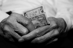 Senior struggling financially Stock Images