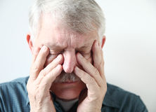 Senior suffering from sinus pressure Royalty Free Stock Image