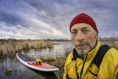 Senior SUP paddler self portrait royalty free stock photo