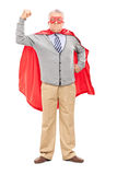 Senior in superhero outfit with his fist in the air Stock Images