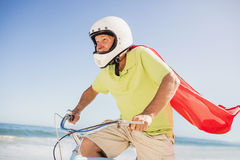 Senior superhero riding bike Royalty Free Stock Images