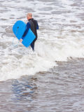 Senior in the surf Stock Images