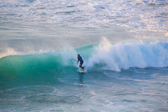 Senior surfer riding a perfect wave. Royalty Free Stock Images