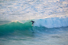 Senior surfer riding a perfect wave. La Pared, Spain - Dec 23, 2015:  Active sporty senior surfer riding perfect wave on La Pared beach, famous surfing Stock Photography