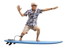 Senior surfing on a surfboard. Isolated on white background stock image