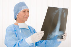 Senior surgeon female hold x-ray operation overall Royalty Free Stock Photos
