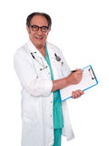 Senior surgeon writing medical report Royalty Free Stock Photography