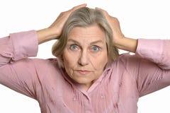 Senior surprised woman isolated Stock Photos