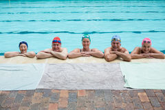 Senior swimmers leaning on poolside. Portrait of senior swimmers leaning on poolside Stock Photo