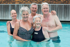 Senior swimmers standing in pool Royalty Free Stock Photos