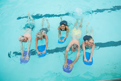 Senior swimmers swimming in pool. High angle view of senior swimmers swimming in pool Stock Photos