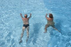 Senior Swimming. A senior couple in a swimming pool Stock Image