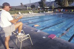 Senior swimming practice. Coach with swimmers, Ojai, CA Stock Image