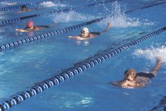 Senior swimming practice with kickboards Royalty Free Stock Photography