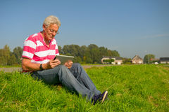 Senior with tablet PC outdoor Royalty Free Stock Image