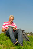 Senior with tablet PC outdoor Royalty Free Stock Images