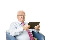 Senior with tablet Royalty Free Stock Photos