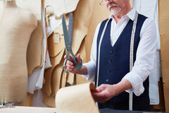 Senior  Tailor Working in Small Atelier Stock Images