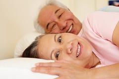 Senior Taiwanese couple resting Stock Photography