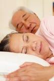 Senior Taiwanese couple sleeping Royalty Free Stock Photos