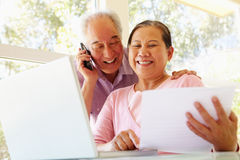 Senior Taiwanese couple working at home Royalty Free Stock Images