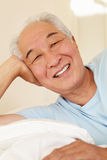 Senior Taiwanese man resting Stock Image