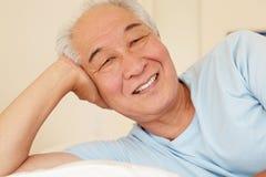 Senior Taiwanese man resting Royalty Free Stock Photo
