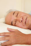Senior Taiwanese man sleeping Stock Photo