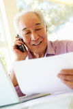Senior Taiwanese man working at home Stock Photography