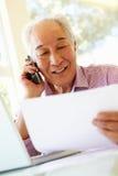 Senior Taiwanese man working at home Stock Images