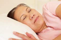 Senior Taiwanese woman sleeping Stock Image
