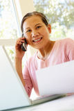 Senior Taiwanese woman working at home Royalty Free Stock Photography