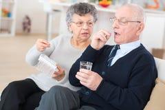 Senior take pills medicine healthcare. Old Stock Photography
