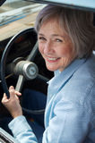Senior Taking a Drive. Smiling senior taking a cruise in the old rustbucket Royalty Free Stock Photography