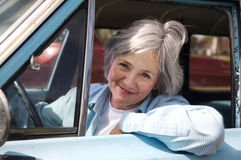 Senior Taking a Drive. Smiling senior taking a cruise in the old rustbucket Stock Photo