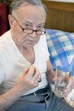 Senior taking meds Stock Images