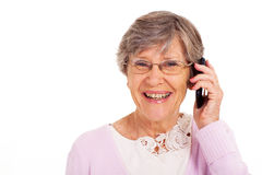 Senior talking on cell Royalty Free Stock Image