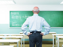 Senior teacher. Portrait of senior teacher in classroom royalty free stock image