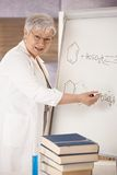 Senior teacher explaining molecular formulas Stock Photos