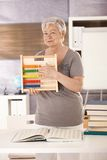 Senior teacher holding abacus Royalty Free Stock Images