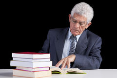Senior teacher reading Books Royalty Free Stock Photos