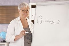Senior teacher teaching chemistry Stock Photo