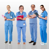Senior team of doctors posing with a smile royalty free stock photography